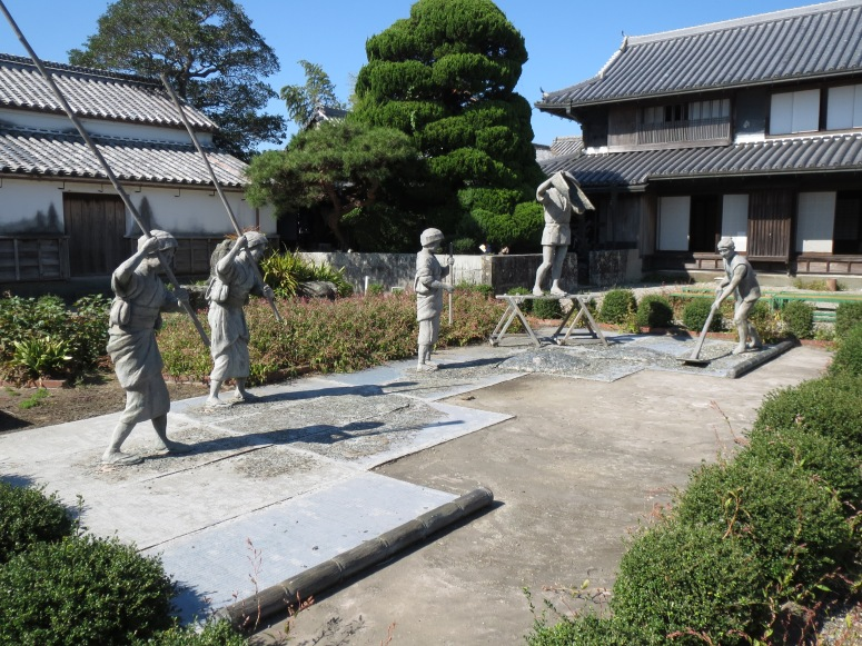 Statues representing the steps of creating aizome.  In the background, you can  see the original family home.