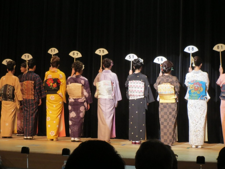 The women's casual competition.  The judges are examining their obi.