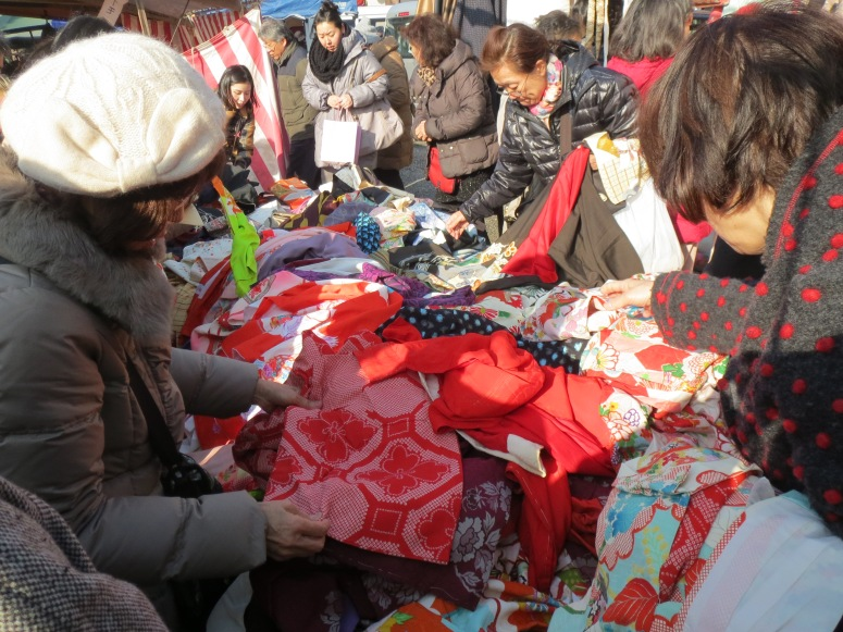 Of course, I was on the lookout for bargain kimono.  Most of the sellers had their wares in a jumbled heap in the middle and it was a free for all.
