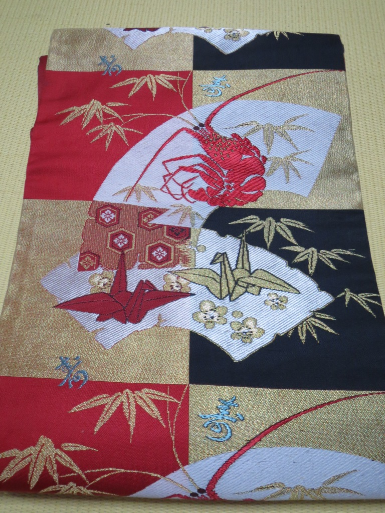 A nagoya obi with lobster and origami cranes.  This was my first purchase of the day and I love it!
