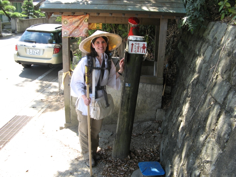 Me at the beginning of my pilgrimage.  I'm standing next to a signpost guiding henro (pilgrims) to the next temple.