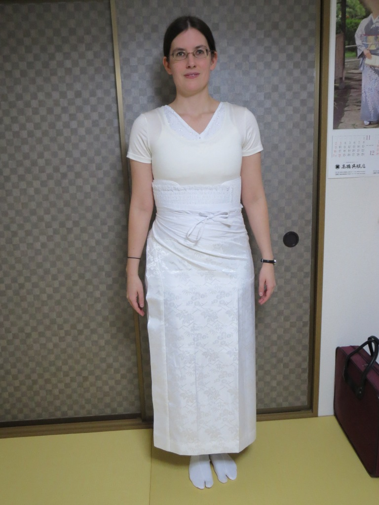 When you put on the skirt, be sure that it is high enough that it won't show under the hem of the kimono.