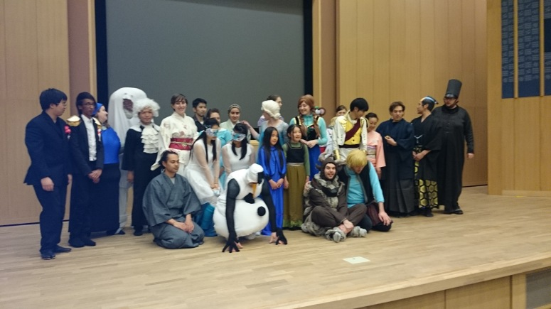 the whole cast fully costumed.  It's a mix of western, instantly recognizable, and kimono.