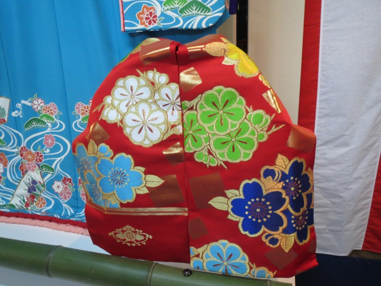 An obi on display. Can you spot the small stitches that keep the two halves in place?