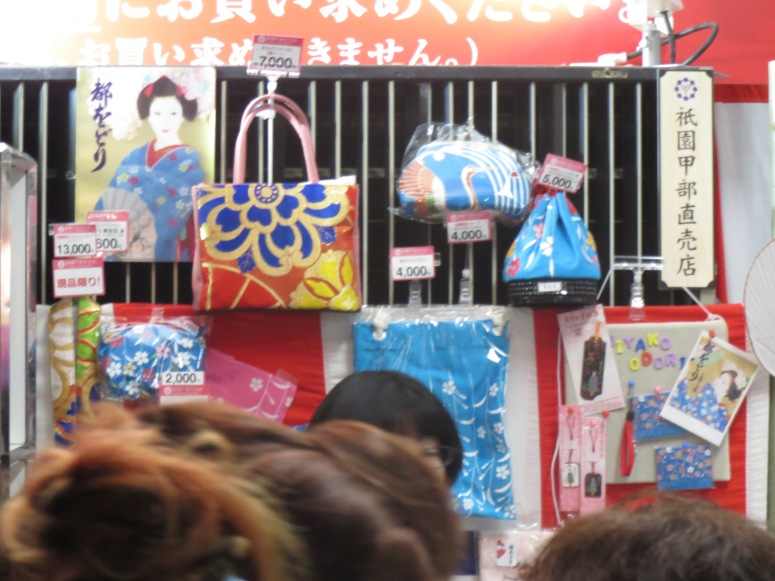 A slightly blurry photo of souvenirs made from previous year's kimono and obi.