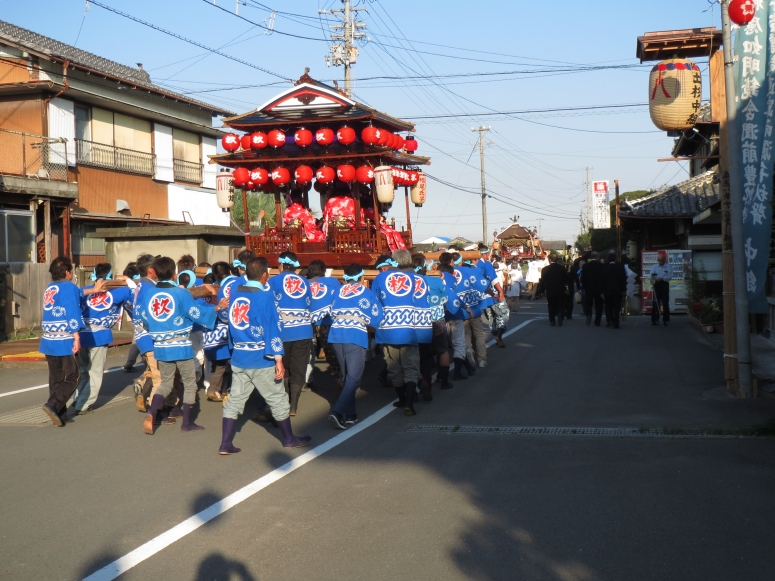 You can see the portable shrine in the front of the procession.