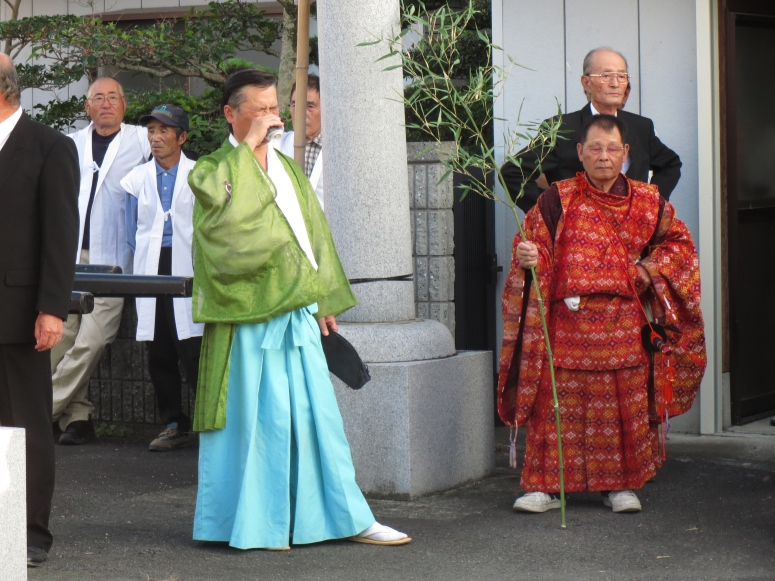 Even the priests get to enjoy the sake and food.